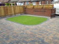 Artificial Grass surrounded by block paving