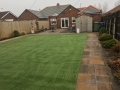 Artificial Grass complimented by patio flags